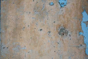 Grunge Wall with Remnants of Blue Paint