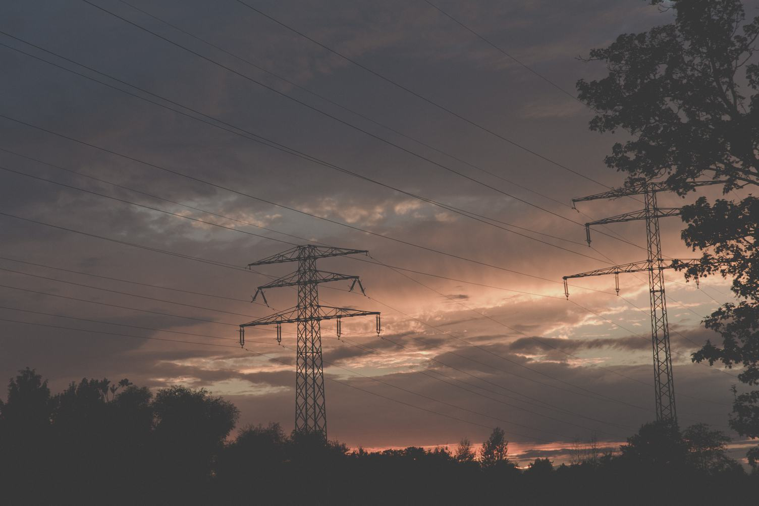 Sunset over High Voltage Pylons