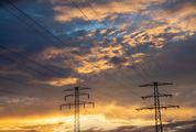 Golden Hour Sky with High Voltage Pylons
